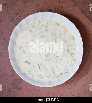 Top view of homemade tzatziki yogurt sauce in a small bowl - Stock Image