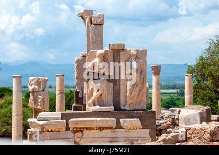 Historic Roman ruins showing the Memmius Memorial at Ephesus Turkey - Stock Image