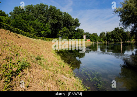 Colorful view on a lake with country path sunny day - Stock Image