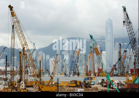 Cranes and skyscrapers, Kowloon, Hong Kong - Stock Image