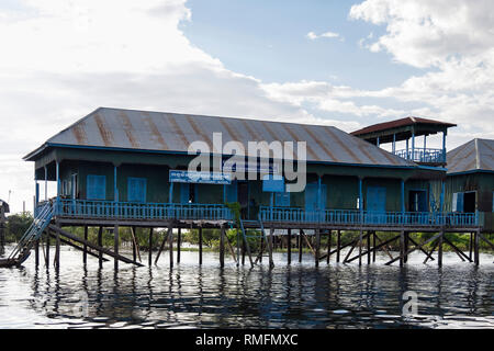 Community Fishery Office and Secondary school on stilts in floating village in Tonle Sap lake. Kampong Phluk, Siem Reap province, Cambodia, Asia - Stock Image