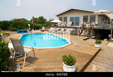 home, pool, enjoyment, swimming, exercise, platform, deck, plants, trees, sky, house, - Stock Image