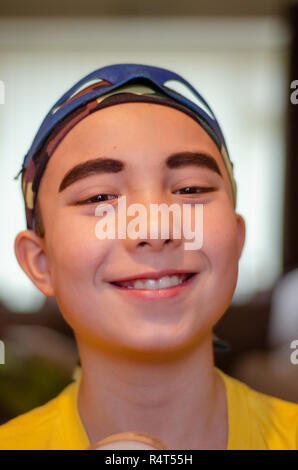 portrait of a boy dressed up as a pirate, wearing eyeliner to make his eyebrows more prominent. - Stock Image
