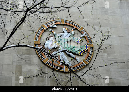 View from street level of huge enamelled metal, Art Deco plaque depicting 'Song', on wall of Radio City - Stock Image