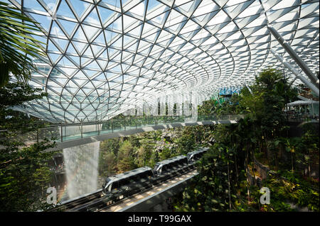 18.04.2019, Singapore, , Singapore - View into the Forest Valley with waterfall in the new Jewel Terminal at Changi International Airport. The design  - Stock Image