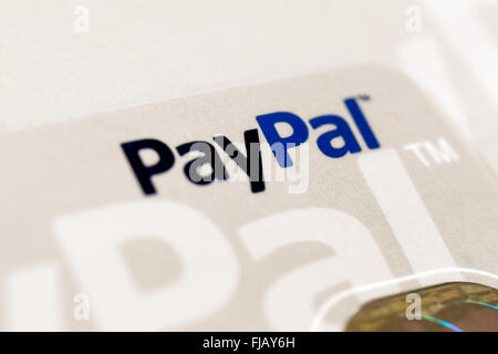 Paypal logo on a credit card. Paypal is a popular commerce platform for  accepting and sending money. - Stock Image