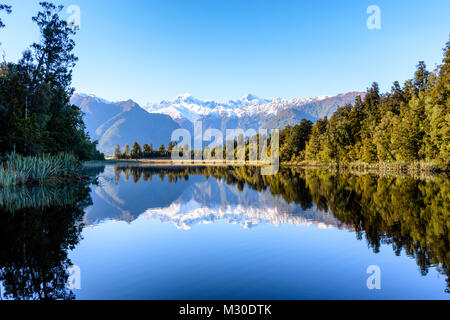Mountain reflections in Lake - Stock Image