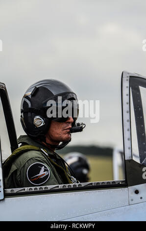 Pilot Ed Shipley of the Horsemen Flight Team in cockpit of North American P-51 Mustang fighter plane preparing to take off at airshow. Space for copy - Stock Image