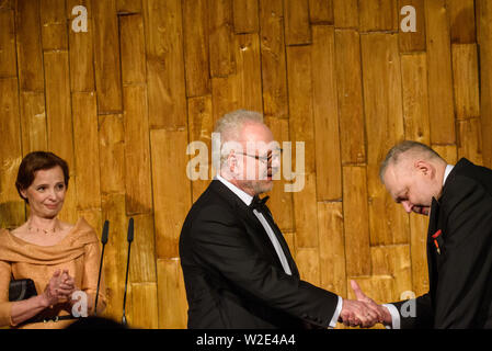 Riga, Latvia. 8th July 2019. Egils Levits giving gift for Andris Vilks, director of LNB (Latvian National Library), during Reception in honour of the inauguration of President of Latvia Mr Egils Levits accompanied by First Lady of Latvia Mrs Andra Levite. Credit: Gints Ivuskans/Alamy Live News - Stock Image