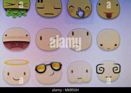 Emojis seen on a computer screen. - Stock Image