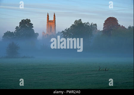 Rural village church tower on a misty autumnal morning at Hampton Lucy, Warwickshire - Stock Image