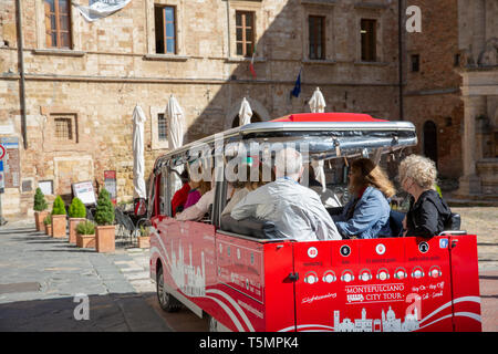 Montepulciano tour sightseeing small bus departs the town square piazza for a tour of this medieval hilltop town in Tuscany,Italy,Europe - Stock Image