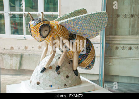 Dazzle Bee by Liz Faram.  One of the Bee in the City sculptures, Library Walk, St. Peter's Square, Manchester, UK. - Stock Image