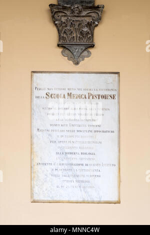 A plaque on the wall of the Lospedale del Ceppo, dating from 1906, relating to Pistoia medical school, Pistoia, Tuscany, Italy, Europe - Stock Image