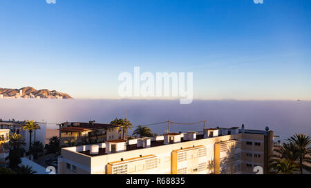 Benidorm, Costa Blanca, Spain, 4th December 2018. Sunbathers and swimmers left the beach early as a sea fret, marine layer or cloudbank rolled in to Poniente and Levante beaches today in Benidorm on the Costa Blanca coast. Credit: Mick Flynn/Alamy Live News - Stock Image