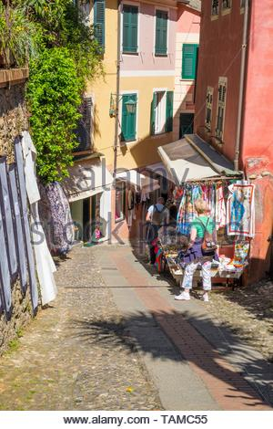 Small street with stall selling fabric, Portofino, Italy. - Stock Image