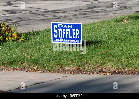 A political sign for election to the House of Representatives planted in a yard in Wichita, Kansas, before the November 2018 election. USA. - Stock Image