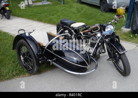 Vintage motorcycle BMW R25/2 from early 50es with side wagon - Stock Image