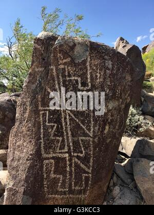 Native Americans carved petroglyphs on rocks at Three Rivers Petroglyph Site near Tularosa, New Mexico - Stock Image