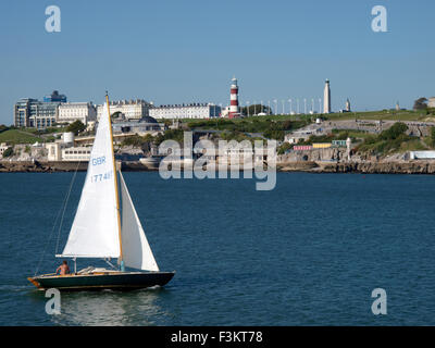 Small yacht sailing up the Plymouth Sound, Devon, UK - Stock Image