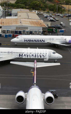 Three Hawaiian Air Boeing 717-200's at Honolulu International airport - Stock Image
