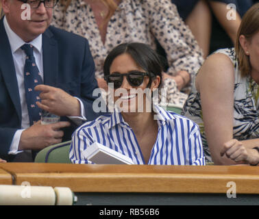 Kate, the Duchess of Cambridge, and Meghan Markle, The Duchess of Sussex, pictured at the All England Lawn Tennis Championships in Wimbledon, England on July 14th 2018 to watch the conclusion of the Gentlemen's Singles semi final between Novak Djokovic and Rafael Nadal and the Ladies' Singles Final between Angelique Kerber and Serena Williams. - Stock Image