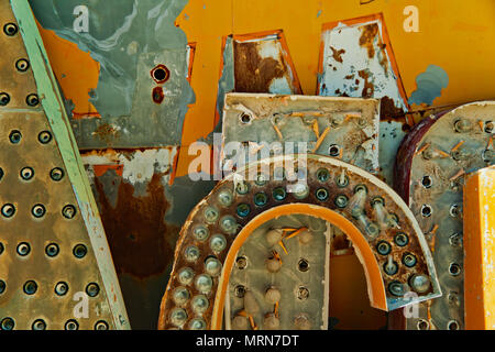 Old Neon Signs with retro construction designs is displayed at Neon Boneyard Museum, Las Vegas, Nevada. It is a popular tourists attraction. - Stock Image