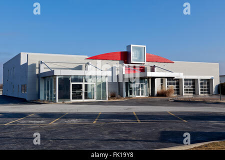 Car dealership out of business, closed and abandoned. Was formerly a Saturn automobile dealer. - Stock Image