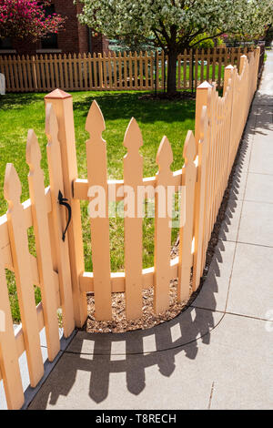 Off white wooden picket fence; Salida; Colorado; USA - Stock Image