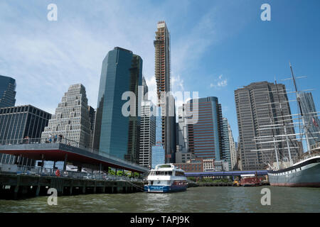 Pier 15 on the East River is home to Hornblower Cruises. Pier 16 provides berths for the South Street Seaport Museum's historic ships. - Stock Image