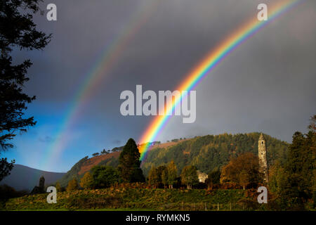 Rainbow at Glendalough over Round Tower county Wicklow - Stock Image