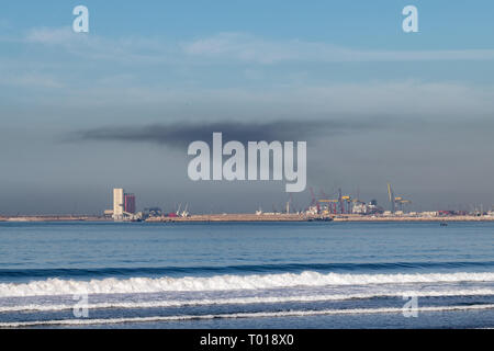 Smoke pollution from the port area of Agadir, Morocco, Africa December 2018 - Stock Image