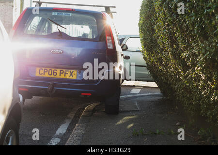 Example of an irresponsible driver  parking illegally on the pavement in Marlborough Road, Falmouth, Cornwall - Stock Image