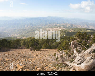 Visiting or taking part in a hike in the Troodos mountains in Cyprus lets tourists experience forests of pine and cedar trees and stunning views - Stock Image