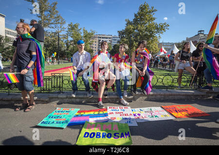 BELGRADE, SERBIA - SEPTEMBER 16, 2018:  Activists raising and holding rainbow gay flags during the Belgrade Gay Pride. The parade happened this year w - Stock Image