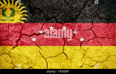 Miranda State flag, state of Venezuela, on dry earth ground texture background - Stock Image