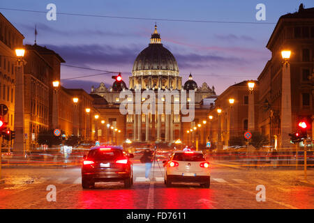 St. Peter's Basilica Rome St. Peter's and street Via della Conciliazone in Rome at dusk, Italy - Stock Image