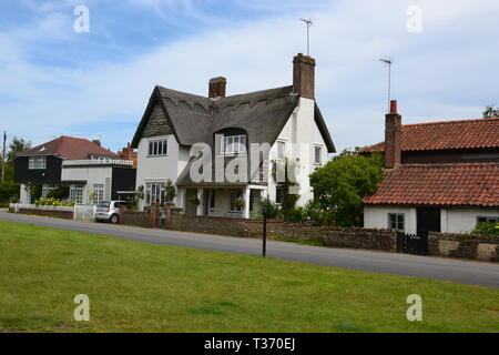 Houses on the Village Green in Walberswick, near Southwold, Suffolk, UK - Stock Image