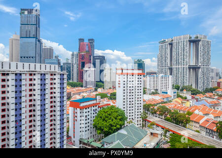 Cityscape of Singapore downtown (Tanjong Pagar) featuring conserved district of shophouses and high-rise public housing (The Pinnacle@Duxton) - Stock Image