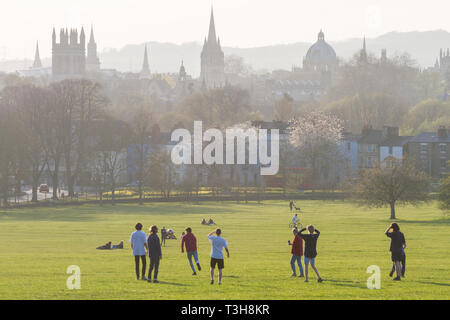 Students play football in South Park with the dreaming spires of Oxford behind - Stock Image
