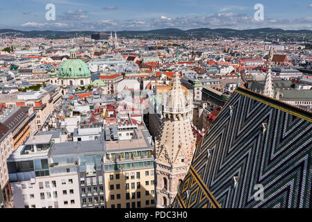 View of Vienna, Austria from St. Stephen's Cathedral with colourful roof - Stock Image