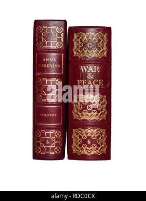 The Easton Press leather-bound editions of Tolstoy's Anna Karenina and War and Peace.  Isolated on white background. - Stock Image