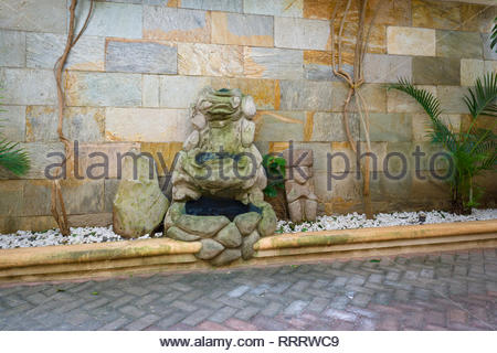 Indigenous and modern sculptures in El Borbon restaurant in Boaco, Nicaragua.   These small indigenous sculpures often look unpleased. - Stock Image