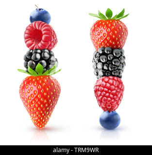Isolated berries pyramids. Strawberry, blackberry, raspberry and blueberry on top of each other isolated on white background with clipping path - Stock Image