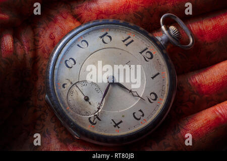 Lip pocket watch on a hand with henna-type ink look and pattern - Stock Image