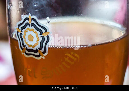 Close up view of a glass of Samuel Smith's Best Bitter in a pint glass showing the white rose of Yorkshire, Beverley, East Riding, Yorkshire, England - Stock Image