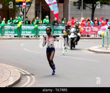 Brigid Kosgei (KEN), and Vivian Cheruiyot (KEN), competing in the Womens Elite 2019 London Marathon.  They went on to finish 1st and 2nd, respectively, in times of  02:18:20 and  02:20:14, respectively - Stock Image
