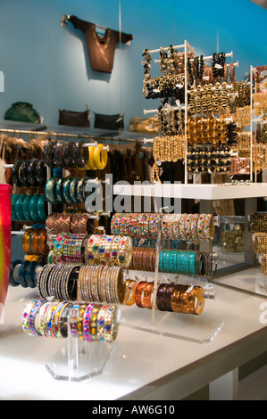Women s fashion clothing on display in Retail store - Stock Image