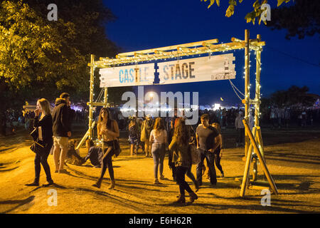 Southsea, UK. 23rd Aug, 2014. Victorious Festival: Entry gate to the Castle Stage area in the twilight. Credit: - Stock Image