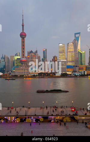 Barges and Pudong skyline at dusk, Shanghai, China - Stock Image